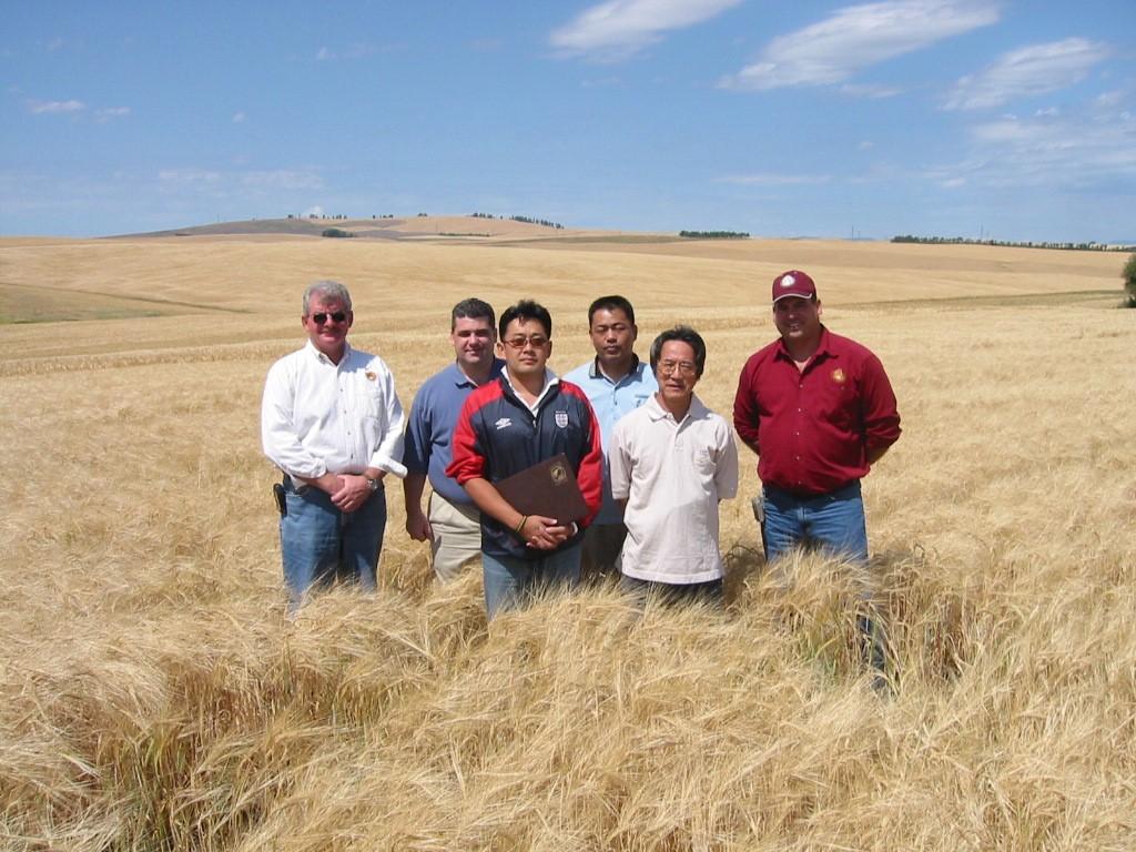 Six People Standing in Field